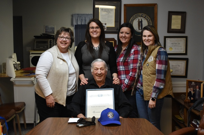 Presenting Mayor Long with a Governor's Citation for his service (Left to Right: Melissa Benton (Kentucky Commission on Community Volunteerism and Service), Cassie Hudson (Executive Director, Partnership Housing), Rachael Marshall (AmeriCorps Alum, Housing Coordinator and Counselor), Amber Henrion (AmeriCorps Member), and Mayor Charles E. Long (front).